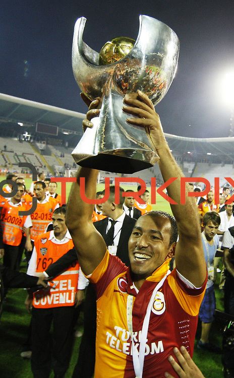 Galatasaray's player Umut Bulut  celebrate with the trophy after their Turkish Super Cup 2012 soccer derby match Galatasaray between Fenerbahce at the Kazim Karabekir stadium in Erzurum Turkey on Sunday, 12 August 2012. Photo by TURKPIX