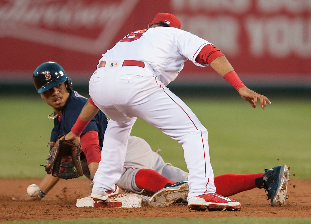 Boston's Mookie Betts is safe after stealing second as the Angels' Gregorio Petit loses the ball at Angel Stadium on Friday.<br /> <br /> ///ADDITIONAL INFO:   <br /> <br /> angels.0730.kjs  ---  Photo by KEVIN SULLIVAN / Orange County Register  -- 7/29/16<br /> <br /> The Los Angeles Angels take on the Boston Red Sox at Angel Stadium.