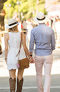 Couple walk hand in hand, The Campo Argentina Del Polo, Buenos Aires, Argentina, South America
