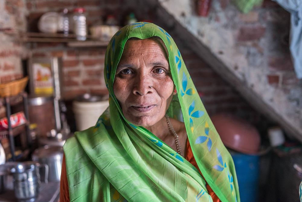 A woman inside her home, Tigri Slum, Delhi