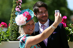 Racegoers take a selfie on day three of Royal Ascot at Ascot Racecourse.