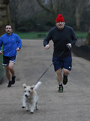 © Licensed to London News Pictures. 22/02/2021. London, UK. Prime Minister Boris Johnson is seen running with his dog Dilyn in Westminster. Mr Johnson is expected to announce his roadmap to easing the lockdown as Covid-19 infection and death rates continue to decline. Photo credit: Peter Macdiarmid/LNP