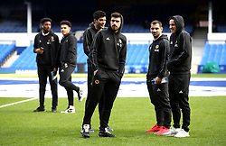 Wolverhampton Wanderers' Ruben Neves (left), Jonny, and Diogo Jota (right) inspect the pitch prior to the match