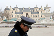 A guard stands in front of the Chateau Changyu Moser XV, which will be open to the public next May, in  Yinchuan, Ningxia Hui Autonomous Region, China on 21 December  2012.  With its dry climates and ample sunshine, and encouraged by the huge boom in Chinese consumer's demand for wine, Ningxia is quickly becoming one of the biggest wine producing regions in China.
