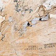 Torn paper and Chinese calligraphy highlight an abstract composition in the Mongolian village of Xin Meng.