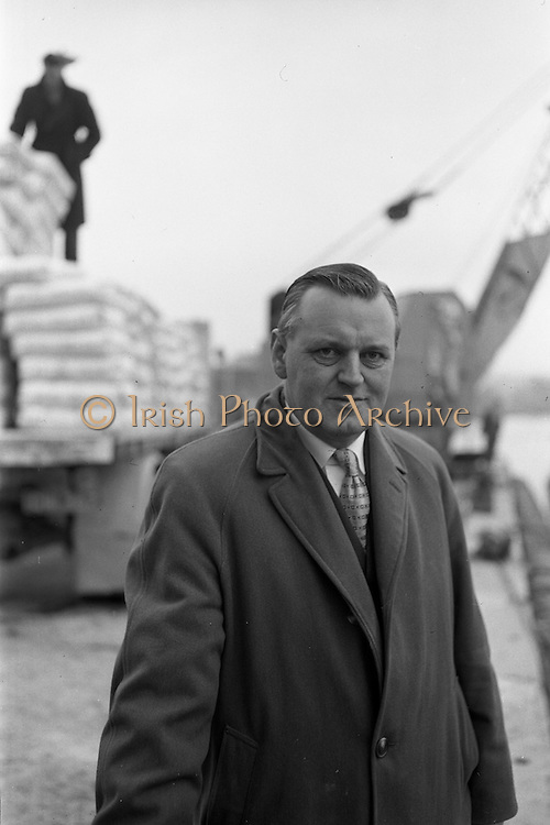 """11/02/1963<br /> 02/11/1963<br /> 11 February 1963<br /> Nitra-Shell 23 cargo discharged at New Ross, Co. Wexford. The """"M.V. Roelf Buisman"""" from Rotterdam on it's first visit to New Ross delivering 500 ton of Nitra -Shell 23 the first consignment of 23% Nitrogen imported into Ireland. Messrs. Albatross Windmill Fertiliser Co. Ltd. were the importers. Picture shows Mr. Edward Francis Storey, Edgewold, New Ross, Managing Director of Albatross Windmill Fertiliser Co. Ltd., New Ross and Vice Chairman of Shell-Albatross Ltd. He was a native of Wicklow and apart from having spent seven years at sea in the merchant navy he was always associated with the seed and fertiliser industry. Married and interested in fishing and gardening."""