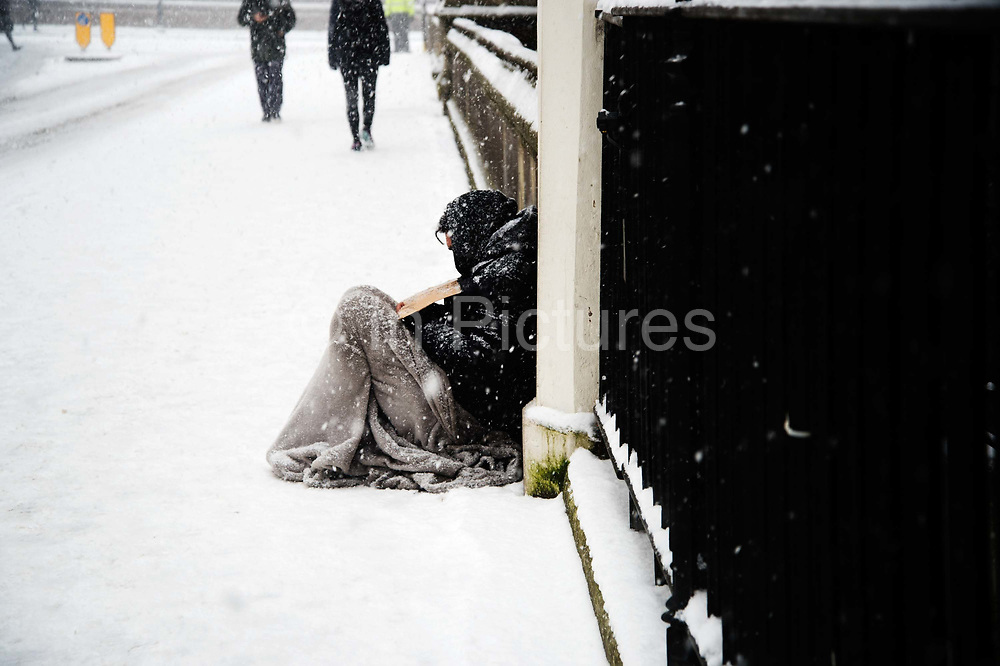 Homeless man begging on the street in freezing weather, dubbed 'The Beast from the East' due to the sub zero cold temperature winds coming in from Siberia, descends on 28th February 2018 in London, United Kingdom. (photo by Jenny Matthews/In Pictures via Getty Images)