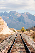 A railroad track heads straight for the Mission Mountains in western Montana. Missoula Photographer, Missoula Photographers, Montana Pictures, Montana Photos, Photos of Montana