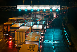 © Licensed to London News Pictures. 03/12/2020. Folkestone, UK. Freight trucks, heading for France, line up at the entrance to the Eurotunnel Terminal near Folkstone. The first consignment of the Pfizer Biontech Covid-19 vaccine is believed to have arrived in the UK after being cleared for UK use by regulators. Photo credit: Peter Macdiarmid/LNP