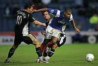 Photo: Lee Earle.<br /> Portsmouth v Wigan Athletic. The FA Cup. 06/01/2007. Portsmouth's Glen Johnson (R) battles his way through Lee McCulloch (L) and Kristoff Haestad.