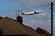 A plane taking off from London's Heathrow Airport, and flying over the Stanwell area of Hounslow Borough.