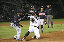 September 6, 2017 - Chicago, IL, USA - Cleveland Indians third baseman Jose Ramirez, left, tags out the Chicago White Sox's Avisail Garcia to end a run down in the fifth inning at Guaranteed Rate Field in Chicago on Wednesday, Sept. 6, 2017. (Credit Image: © Armando L. Sanchez/TNS via ZUMA Wire)