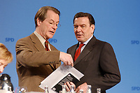 """10 MAR 2002, MAGDEBURG/GERMANY:<br /> Franz Muentefering (L), SPD Generalsekretaer, und Gerhard Schroeder (R), SPD, Bundeskanzler, im Gespraech, gemeinsamer Parteitag der ostdeutschen SPD Landesverbaende unter dem Motto:""""Richtung Zukunft. Politik fuer Ostdeutschland."""", Hotel Maritim<br /> IMAGE: 20020310-01-086<br /> KEYWORDS: Party congress, Gerhard Schröder, Franz Müntefering, Generalsekretär"""