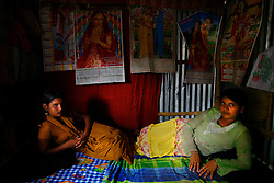 Sex workers Purnima, 16, right, and Pinky, 16,  are seen at brothel in Dorothea, Bangladesh. They have been sex worker for 4 to 5 years. Pinky was born into the brothel. They are best friends.