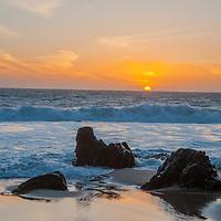 Eroded rocks rise above the waves at Panther Beach, north of Santa Cruz, California.