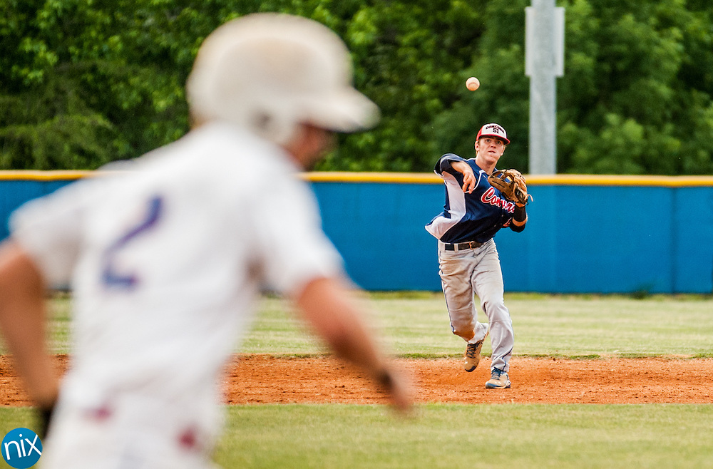 Concord Post 51's Brett Barrier throws a runner out against Mooresville Post 66 Monday night at Lake Norman High School. Concord won the game 6-5.