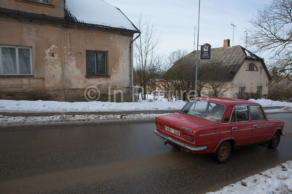 An old car drives through the historic town of Cesis on the 14th February 2019 in Cesis in Latvia. Cesis is a town in northeastern Latvia, known for its medieval castle.