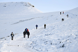 © Licensed to London News Pictures. 04/12/2020. <br /> People head up Penyfan, in the Brecon Beacons, the highest point in southern Wales and England, which has seen it's first snowfall of the year. Photo credit: Robert Melen/LNP