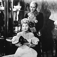 """movie, """"Letter from an unknown Woman"""", after novel by Stefan Zweig, director: Max Ophuels, scene with: Joan Fontaine, Marcel Journet, history, pearl necklet, dress, strapless, puff sleeve, holding etui, half length, Oph¸ls, Ophuls<br /> <br /> Copyright Friedrich Rauch/Interfoto/Writer Pictures<br /> contact +44 (0)20 822 41564 <br /> sales@writerpictures.com <br /> www.writerpictures.com UK RIGHTS ONLY / NO FOREIGN SALES / NO FOREIGN AGENT SALES"""