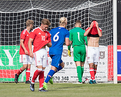 RHYL, WALES - Saturday, September 2, 2017: Wales players look dejected after conceding third goal during an Under-19 international friendly match between Wales and Iceland at Belle Vue. (Pic by Gavin Trafford/Propaganda)