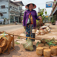 A woman selling bamboo baskets in which rice, mainly glutinous rice, can be steamed.