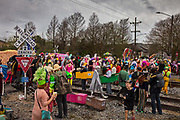 The Society of Saint Anne crossing the rail tracks and gathering to parade during Mardi Gras on 25th February 2020 in Bywater district of New Orleans, Louisiana, United States. Mardi Gras is the biggest celebration the city of New Orleans hosts every year. The magnificent, costumed, beaded and feathered party is laced with tradition and  having a good time. Celebrations are concentrated for about two weeks before and culminate on Fat Tuesday the day before Ash Wednesday and Lent.