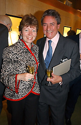 WILLIAM TALLON and CATHERINE PURCELL at an exhibition of fine jewellery at Wartski's, Grafton Street, London on 15th May 2006.<br />