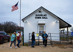 """Voters left and arrived at Douglas Town Hall on Election Day on Tuesday, November 6, 2018, in the area of Douglas Township, Minn. The town hall has 494 registered voters and has a steady flow of people throughout the day. It also has a sign out front that says, """"If you need curbside voting honk three times and we will bring you a ballot"""" meant for elderly or disabled people. Photo by Renee Jones Schneider/Minneapolis Star Tribune/TNS/ABACAPRESS.COM"""