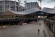 Coal Drops Yard set out for social distancing on 14th March 2021 in Kings Cross, London, United Kingdom. Coal Drops Yard is a shopping complex and privately owned public space that forms part of the Kings Cross Central development scheme in London, England. The development was designed by Thomas Heatherwick and opened in October 2018.