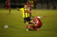 Pierce Sweeney of Exeter tackles Jack Muldoon of Harrogate  during the EFL Sky Bet League 2 match between Harrogate Town and Exeter City at the EnviroVent Stadium, Harrogate, United Kingdom on 19 January 2021.