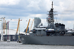 "© Licensed to London News Pictures. 31/07/2016. A 143-metre-long Japanase navy ship has sailed up the Thames and into London. The training ship passed under Tower Bridge at 1pm and moored alongside HMS Belfast. She was commissioned in 1995 and notably had a small collision with the QE2 cruise ship in 2000, after which a Japanese admiral noted it had been ""an honour to be kissed by the Queen Elizabeth."" JDS Kashima remains in London until Wednesday afternoon. Credit: Rob Powell/LNP"