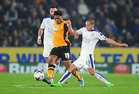 Hull City's Chuba Akpom is tackled by Leicester City's Gokhan Inler<br /> <br /> Photographer Chris Vaughan/CameraSport<br /> <br /> Football - Capital One Cup Round 4 - Hull City v Leicester City - Tuesday 27th October 2015 - Kingston Communications Stadium - Hull<br />  <br /> © CameraSport - 43 Linden Ave. Countesthorpe. Leicester. England. LE8 5PG - Tel: +44 (0) 116 277 4147 - admin@camerasport.com - www.camerasport.com