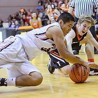 Gallup Bengal Cyrus John (30) and Aztec Tiger Jake Feil (2) dive after the ball Tuesday at Gallup High School.