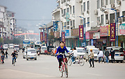 Woman on a bicycle in Yangshuo street, China