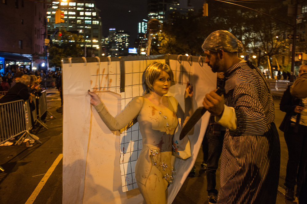 New York, NY, October 31, 2013. A couple reenacts the murder scene in the movie Psycho, complete with shower stall, in the Greenwich Village Halloween Parade.