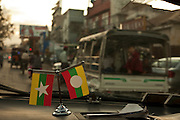 The flag of Myanmar in a taxi, between Hsipaw and Mandalay, Myanmar.<br />