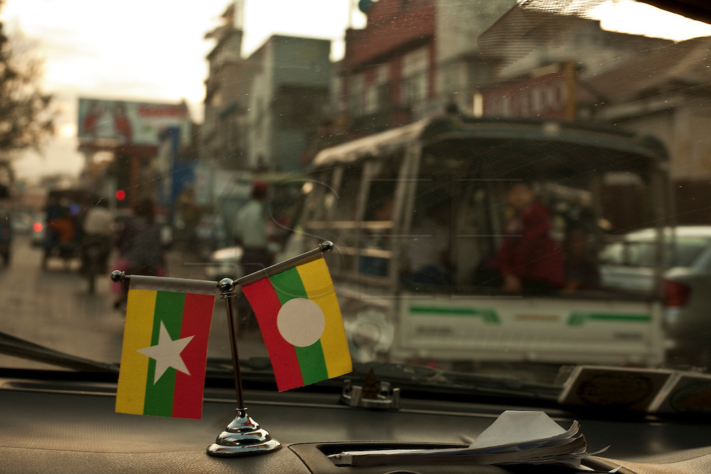 The flag of Myanmar in a taxi, between Hsipaw and Mandalay, Myanmar.<br /> Note: These images are not distributed or sold in Portugal