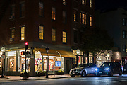 Street scene at night - traffic and traffic lights - in historic district of Charles Street and Chestnut Street, city of Boston, Massachusetts, USA