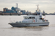 The British Royal Navy Patrol boat, HMS Example P165 seen in front of the Thames Barrier on the River Thames in London, England on September 14, 2018.