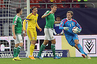 ROMANIA, Bucharest : Northern Ireland's goalkeeper Roy Caroll (R) vie for the ball during the Euro 2016 Group F qualifying football match Romania vs Northern Ireland in Bucharest, Romania on November 14, 2014.