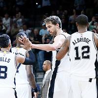 04 April 2017: San Antonio Spurs guard Patty Mills (8) is congratulated by San Antonio Spurs center Pau Gasol (16) during the San Antonio Spurs 95-89 OT victory over the Memphis Grizzlies, at the AT&T Center, San Antonio, Texas, USA.