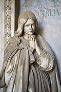 Picture and image of the stone sculpture of a young women grieving in the Borgosie Realistic style. The Gatti Tomb sculpted by G Benetti 1875. Section D no 5, the monumental tombs of the Staglieno Monumental Cemetery, Genoa, Italy .<br /> <br /> Visit our ITALY PHOTO COLLECTION for more   photos of Italy to download or buy as prints https://funkystock.photoshelter.com/gallery-collection/2b-Pictures-Images-of-Italy-Photos-of-Italian-Historic-Landmark-Sites/C0000qxA2zGFjd_k<br /> If you prefer to buy from our ALAMY PHOTO LIBRARY  Collection visit : https://www.alamy.com/portfolio/paul-williams-funkystock/camposanto-di-staglieno-cemetery-genoa.html