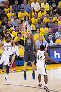 Golden State Warriors guard Klay Thompson (11) shoots a three pointer between two New Orleans Pelicans defenders at Oracle Arena during Game 2 of the Western Semifinals in Oakland, California, on May 1, 2018. (Stan Olszewski/Special to S.F. Examiner)
