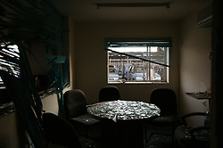 A conference room sits empty at the site of the  explosion at the Canal Hotel Aug. 21, 2003 in Baghdad, Iraq. Earlier in the week a cement truck packed with explosives detonated outside the offices of the UN headquarters in Baghdad, Iraq, killing 20 people and devastating the facility in an unprecedented suicide attack against the world body. At least 100 people were wounded.