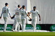 Warwickshire's Keith Barker is congratulated after taking the catch of Hampshires Fidel Edwards of the bowling of Rikki Clarke during the Specsavers County Champ Div 1 match between Hampshire County Cricket Club and Warwickshire County Cricket Club at the Ageas Bowl, Southampton, United Kingdom on 12 April 2016. Photo by Graham Hunt.