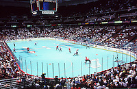 25 July 1998: IIHF World Championships game. Overview of team Canada playing on the blue roller hockey court inside the Arrowhead Pond in Anaheim.   Transparency slide scan.