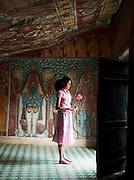 Girl in a Buddhist temple at the Mulkirigala Monastery, Sri Lanka