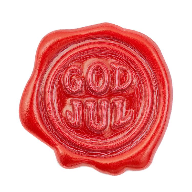 Rødt lakksegl med teksten «god jul», isolert mot hvit bakgrunn.
