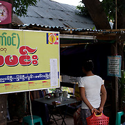 May 15, 2013 - Meiktila, Myanmar: A bus ticket shop in Meiktila, displays a sticker for the 969 anti-Muslim movement. Stickers with the movement's logo are now common nationwide on cars, motorcycles and shops. CREDIT: Paulo Nunes dos Santos