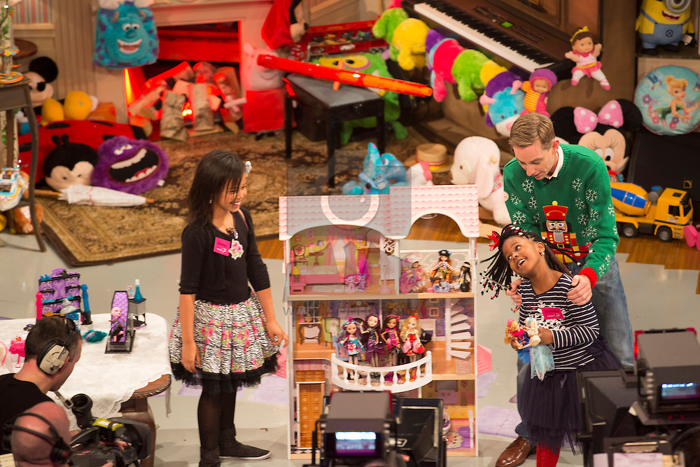 Toy Demonstrators, Rhianna (10) and Destiny (6) Ewohime from Kilkenny pictured on RTE's Late Late Toy Show 2013 with presenter Ryan Tubridy. Picture Andres Poveda
